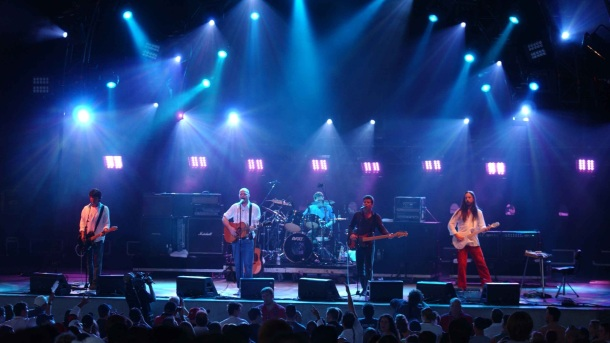 Paul Langlois (far left), member of Tragically Hip, suffers sudden hearing loss.